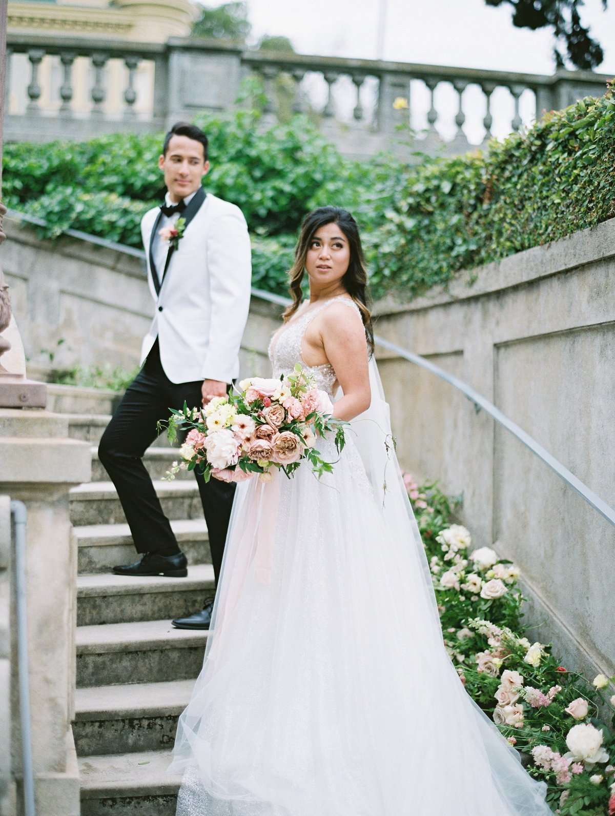daniel-and-bethany-weddings-groom-bride-walking-stairs
