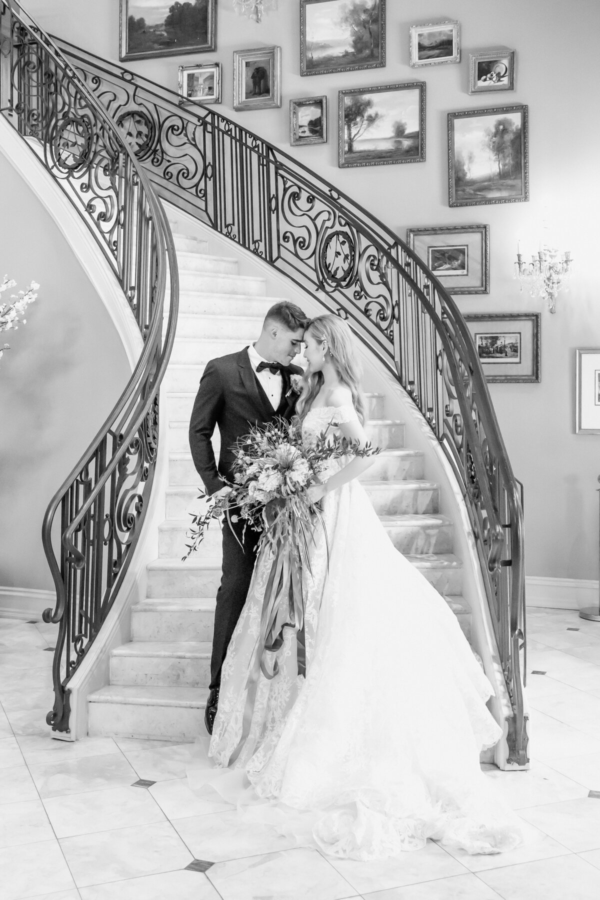 Bride anBride and Groom portraits in The Park Chateau Estate and Gardens entry stairway