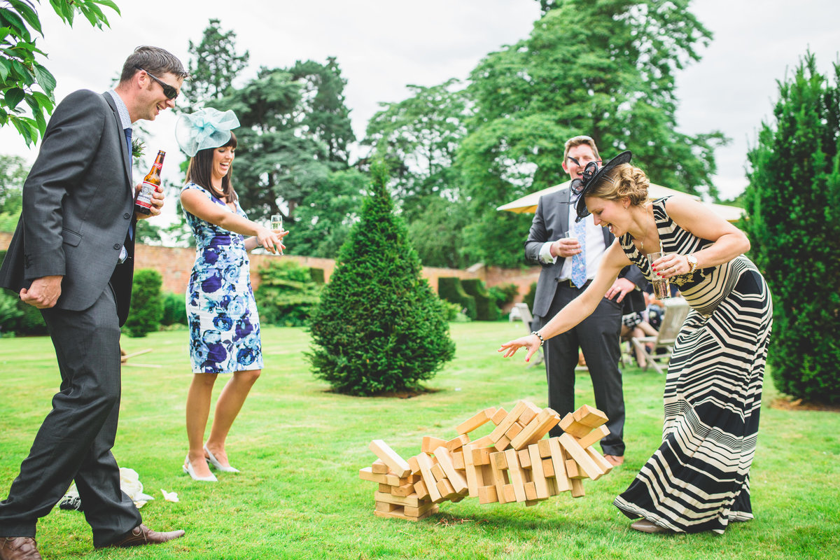 wedding guests playing gian jenga at a combermere abbey wedding