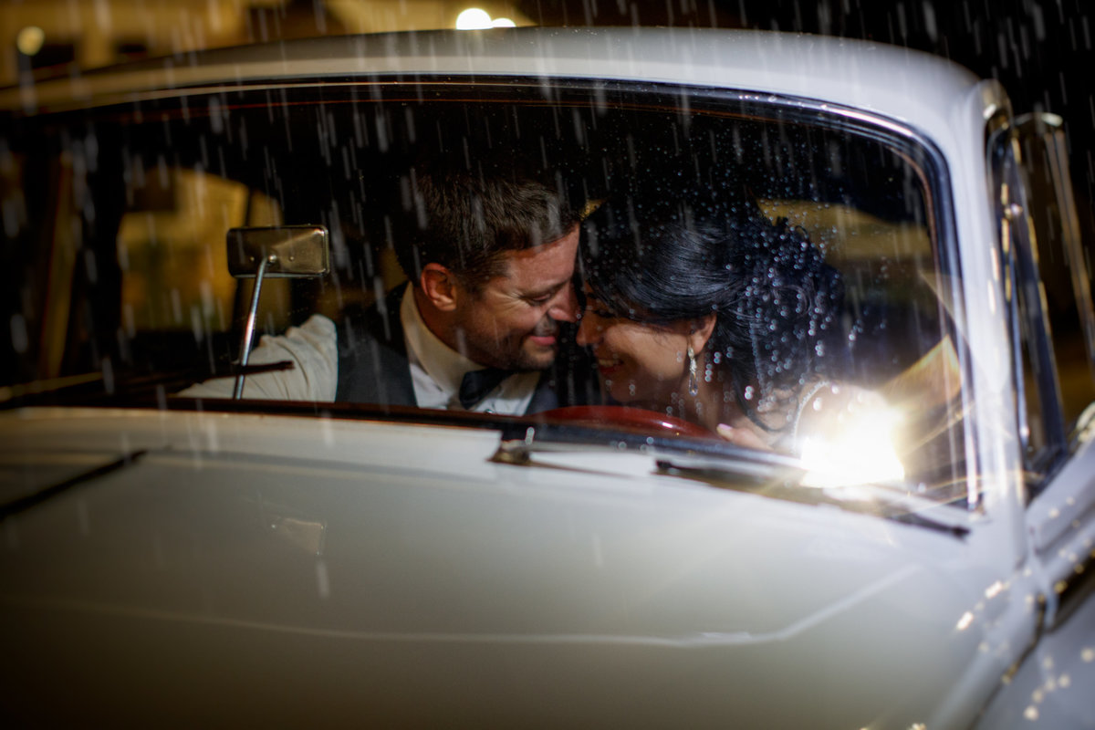 Casa Blanca Wedding photographer couple car rain hispanic bride groom family rain 2211 Hairy Man Rd, Round Rock, TX 78681