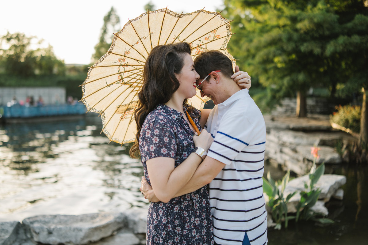 Engaged same sex couple with parasol at the Historic Pearl on the San Antonio riverwalk
