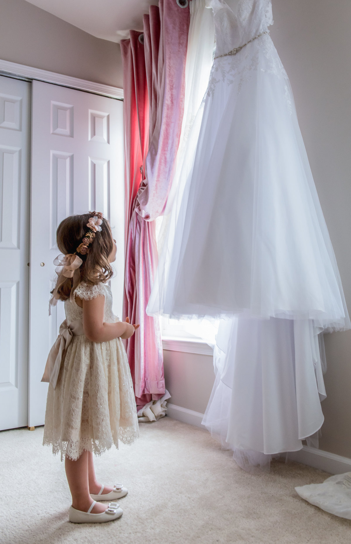 Little Girl looking at wedding dress