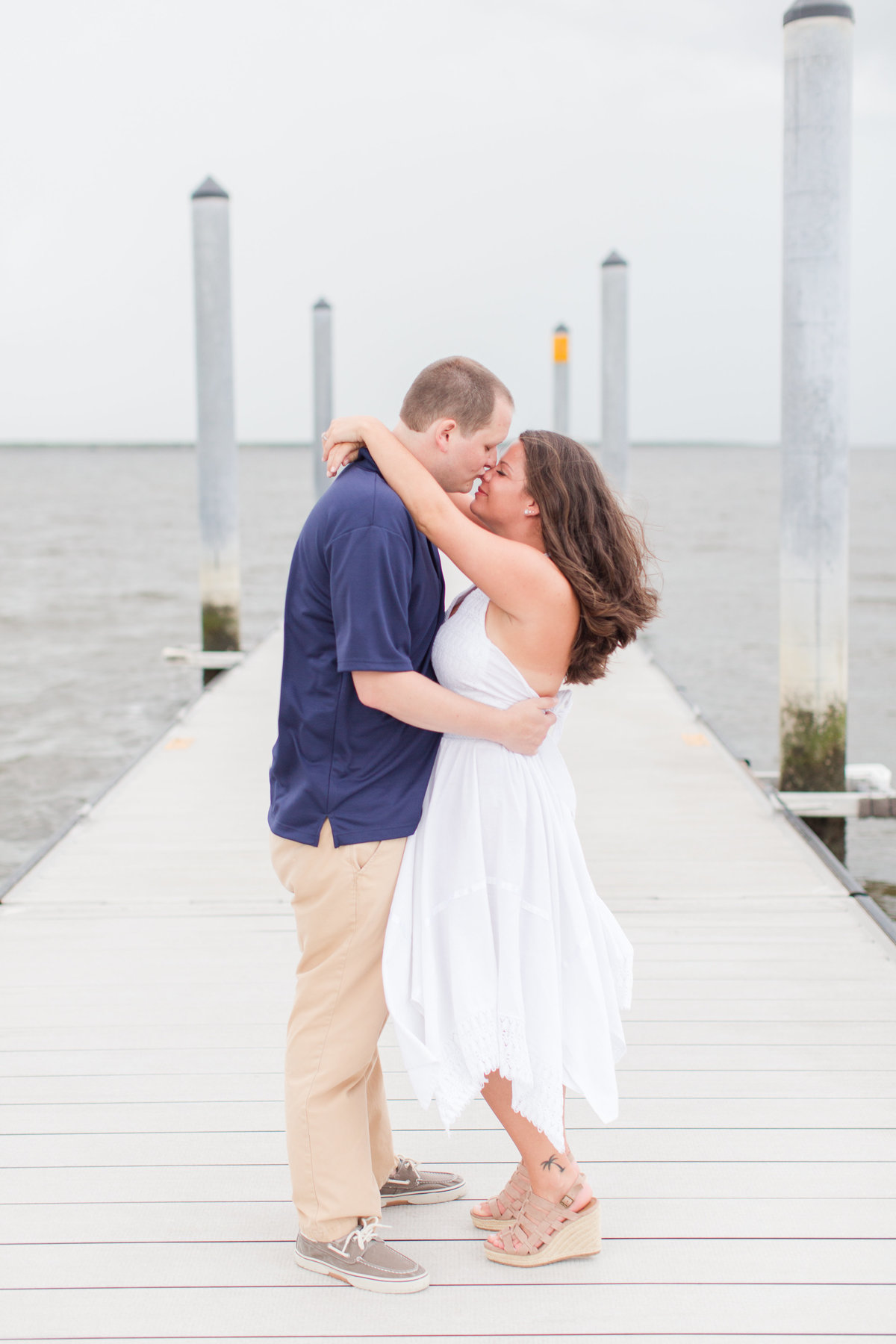 couple embracing for engagement pictures
