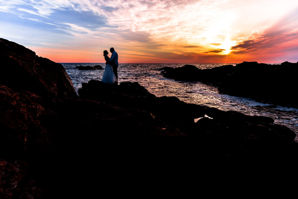 Ogunquit Maine Elopement with the couple standing in front of the sunrise on the day of their wedding