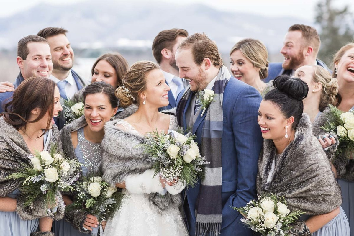 Bride, Groom, and their wedding party at their winter wedding