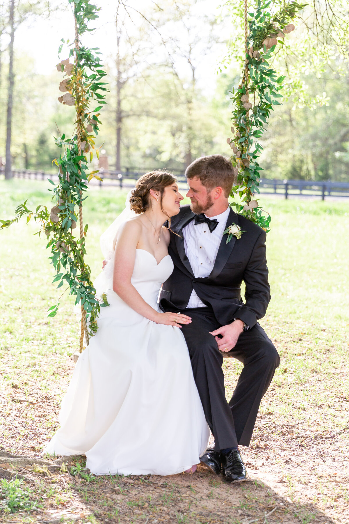 Bride and Groom On the Swing at The Carriage House