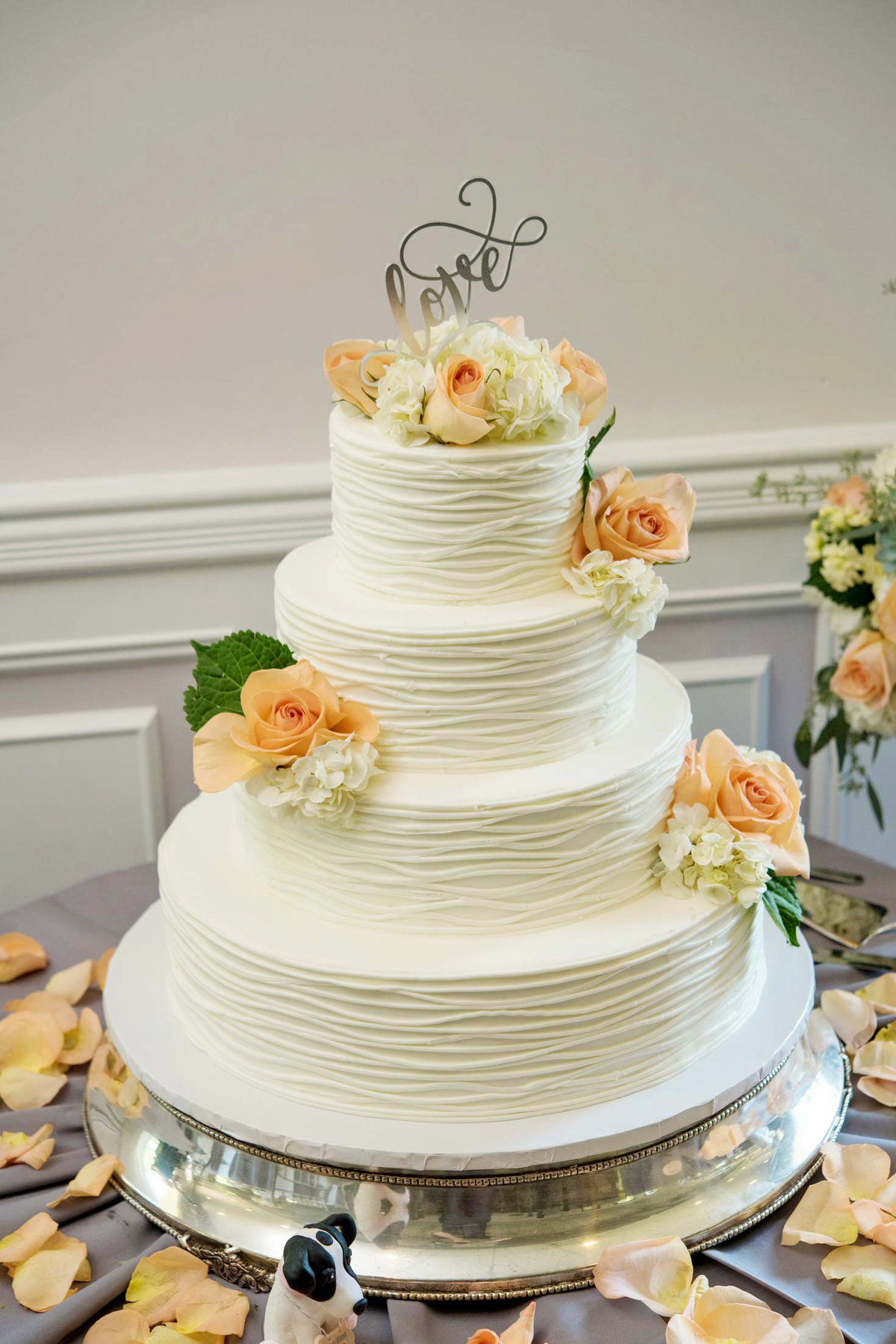 White wedding cake with flowers at Flowerfield