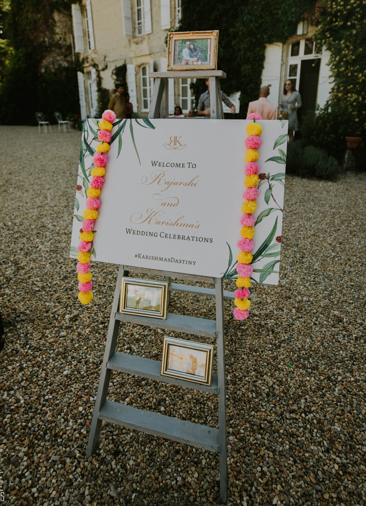 Wedding welcome sign with floral garlands