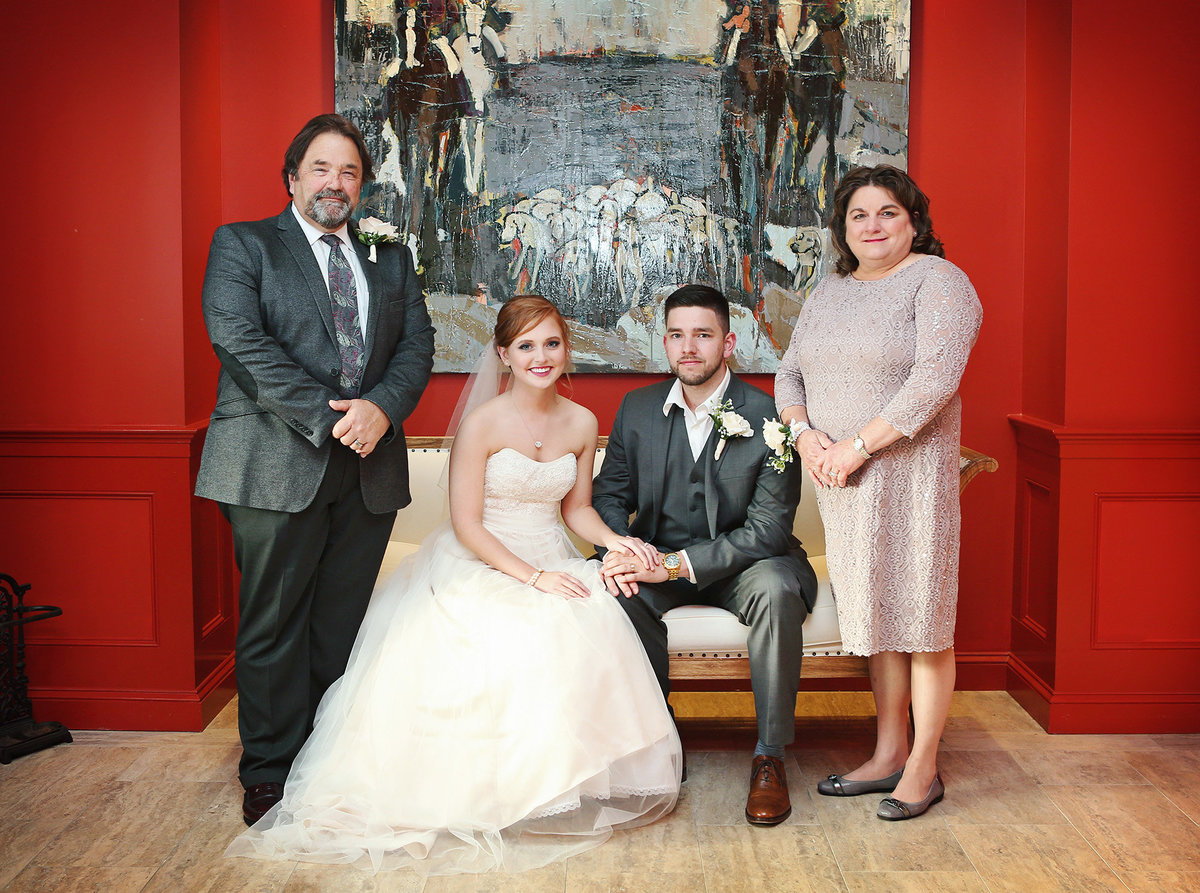 formal family portrait in the red room of The Southern Hotel in Covington, Louisiana
