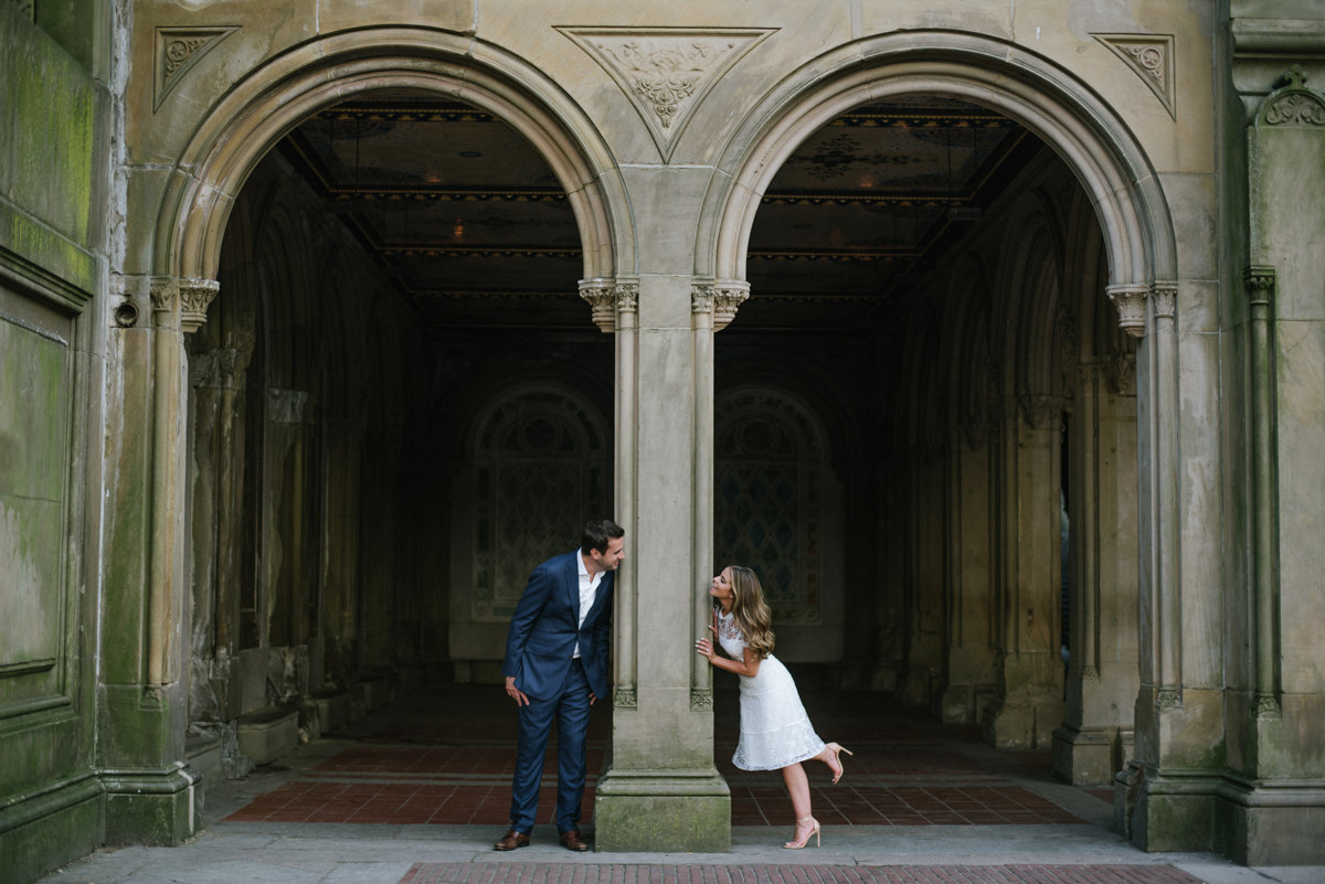 playful engagement photo at bethededa terrace in central Park