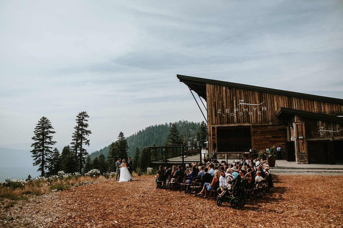 wedding ceremony in front of the Zephyr Lodge at the Northstar Resort in Lake Tahoe, CA