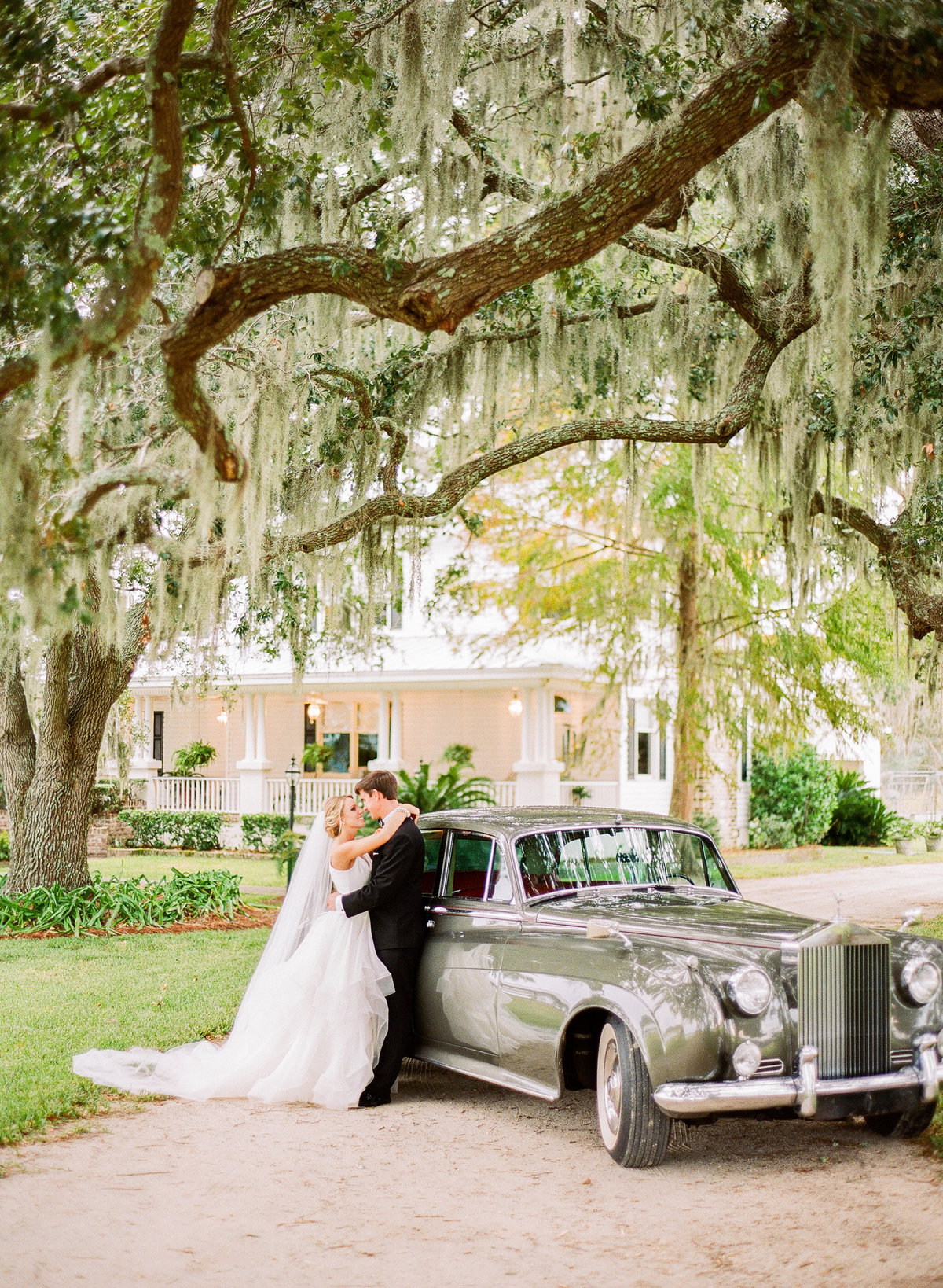 Charleston Newlywed couples portraits with 1961 rolls royce getaway car
