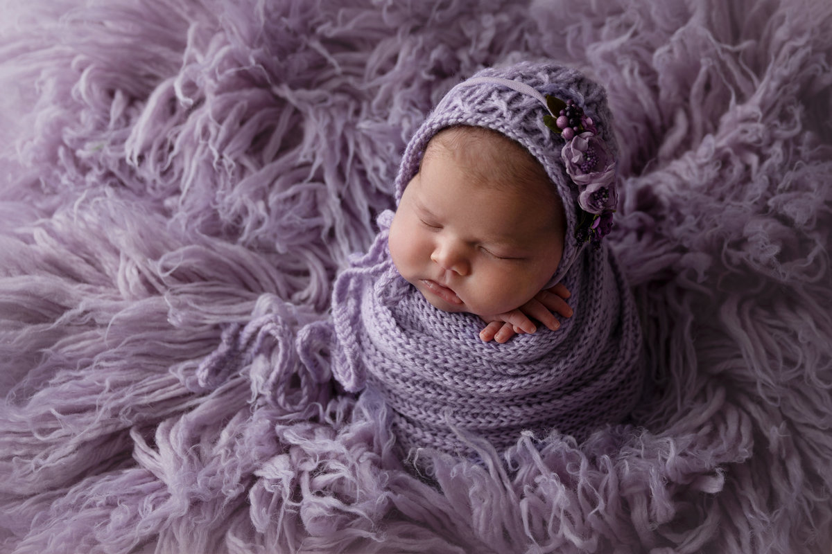 Baby girl in purple
