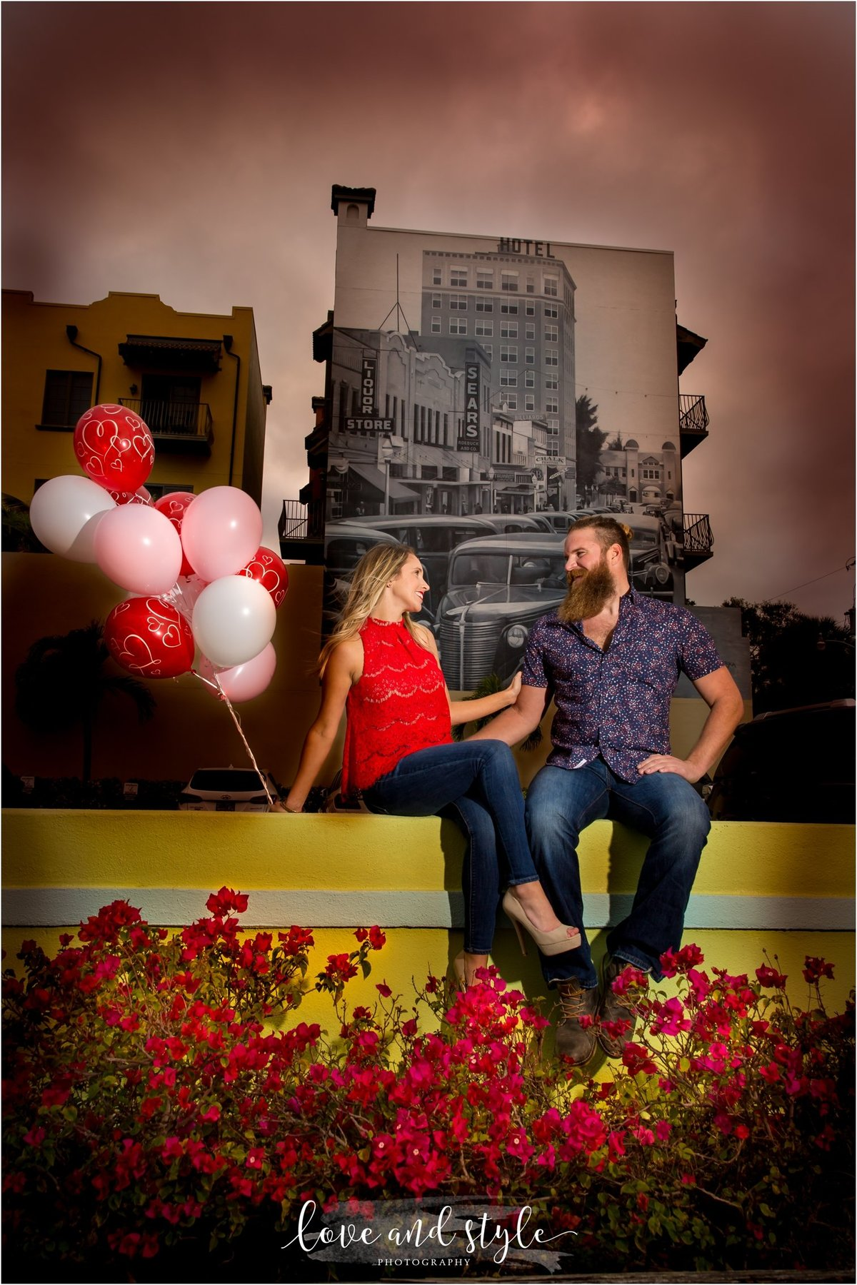 Sarasota Engagement Photography of couple with  red and pink balloons downtown Sarasota