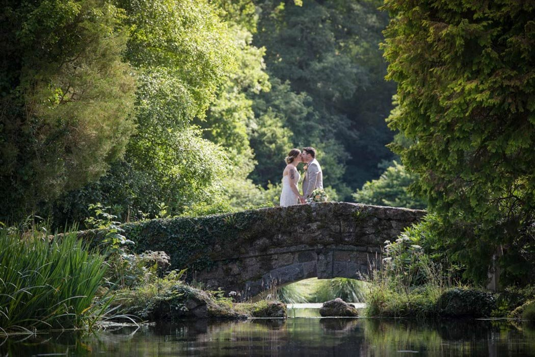 Bride and Groom on Bridge at Bovey Castle Wedding Devon
