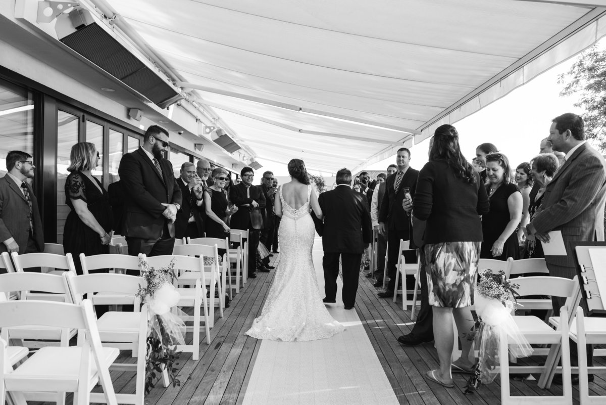 Black and white photo of a ceremony at Harbor Club at Prime