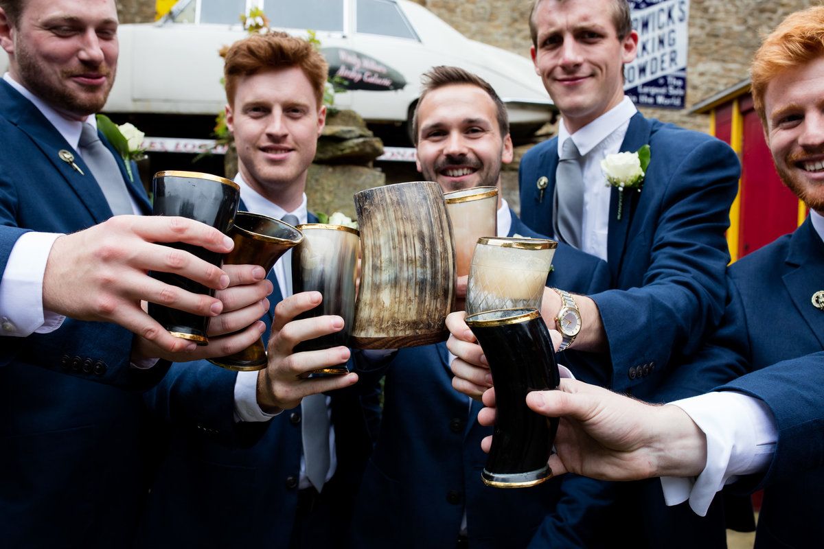 cheers with the groomsmen at haselbury mill