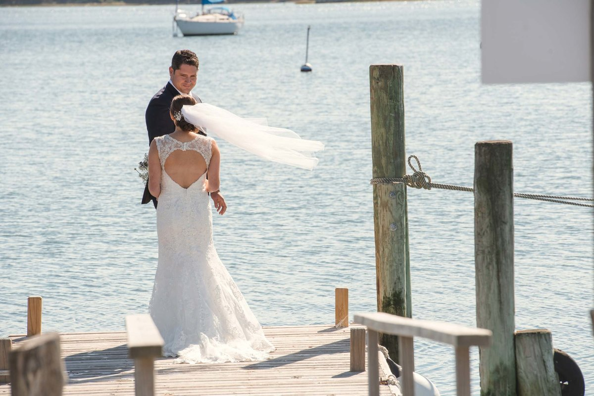 Bride and groom on the dock at The Ram's Head Inn