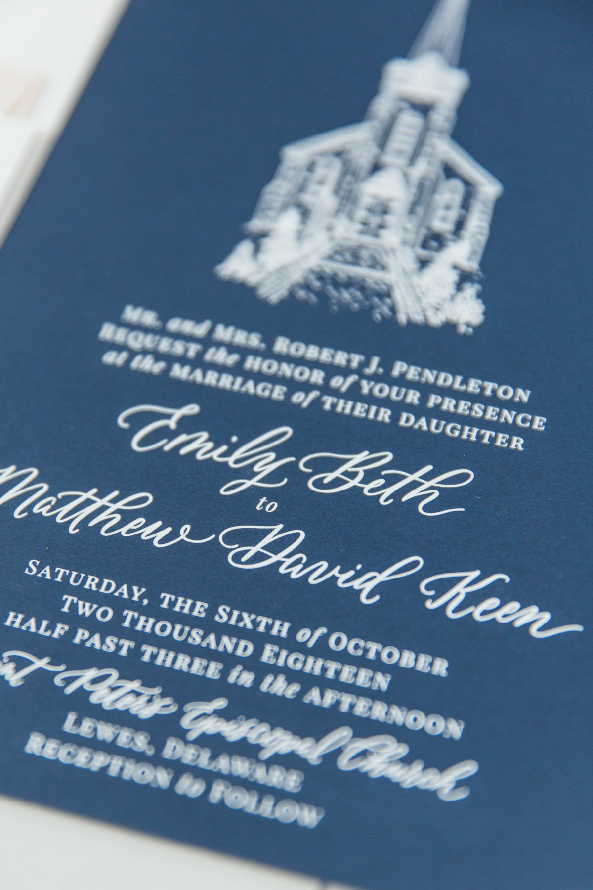 Custom hand lettering wedding invitation on blue paper and white ink