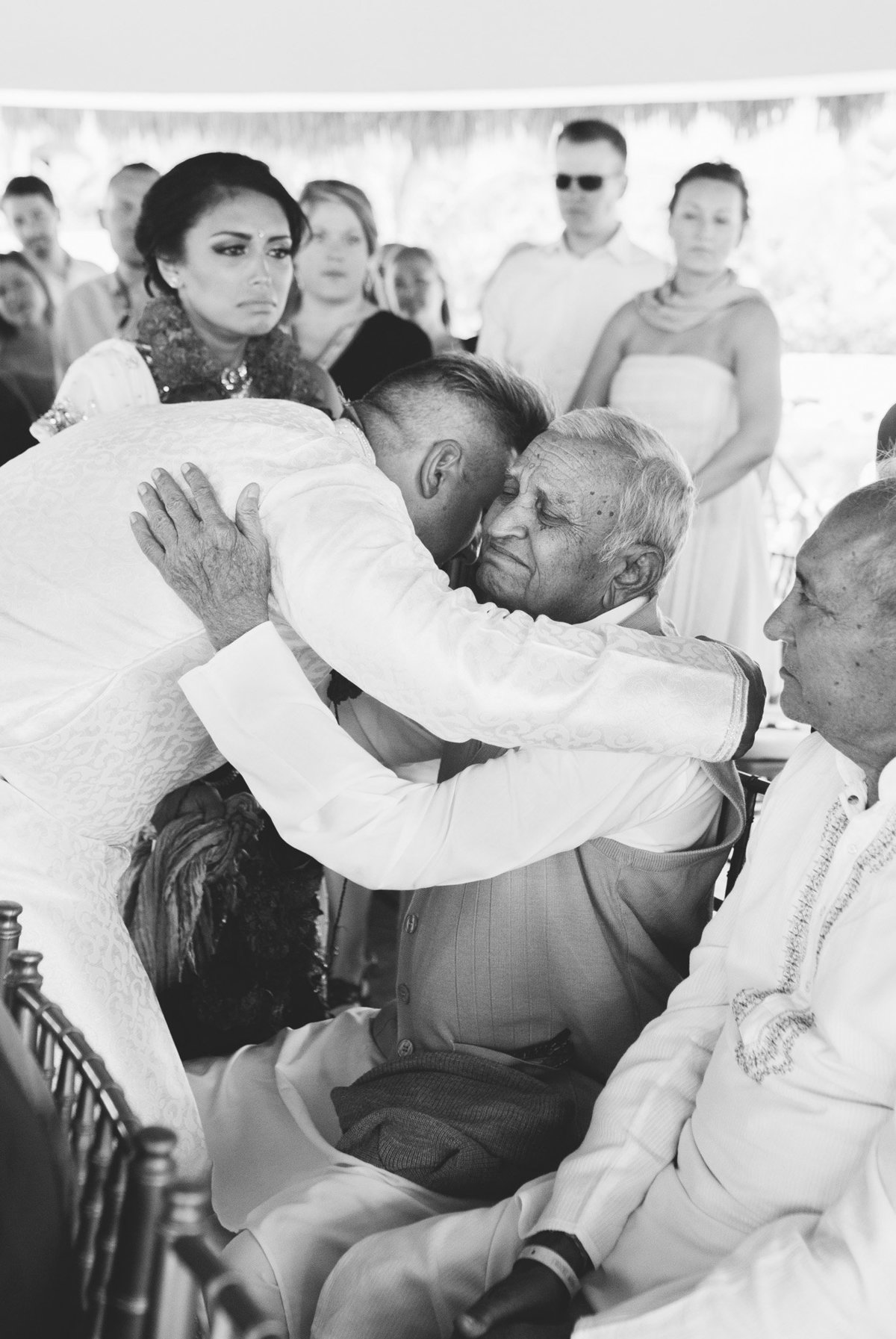 So much emotion for this family member who traveled from India to celebrate with them.  Rebecca Cerasani Destination Wedding photographer.