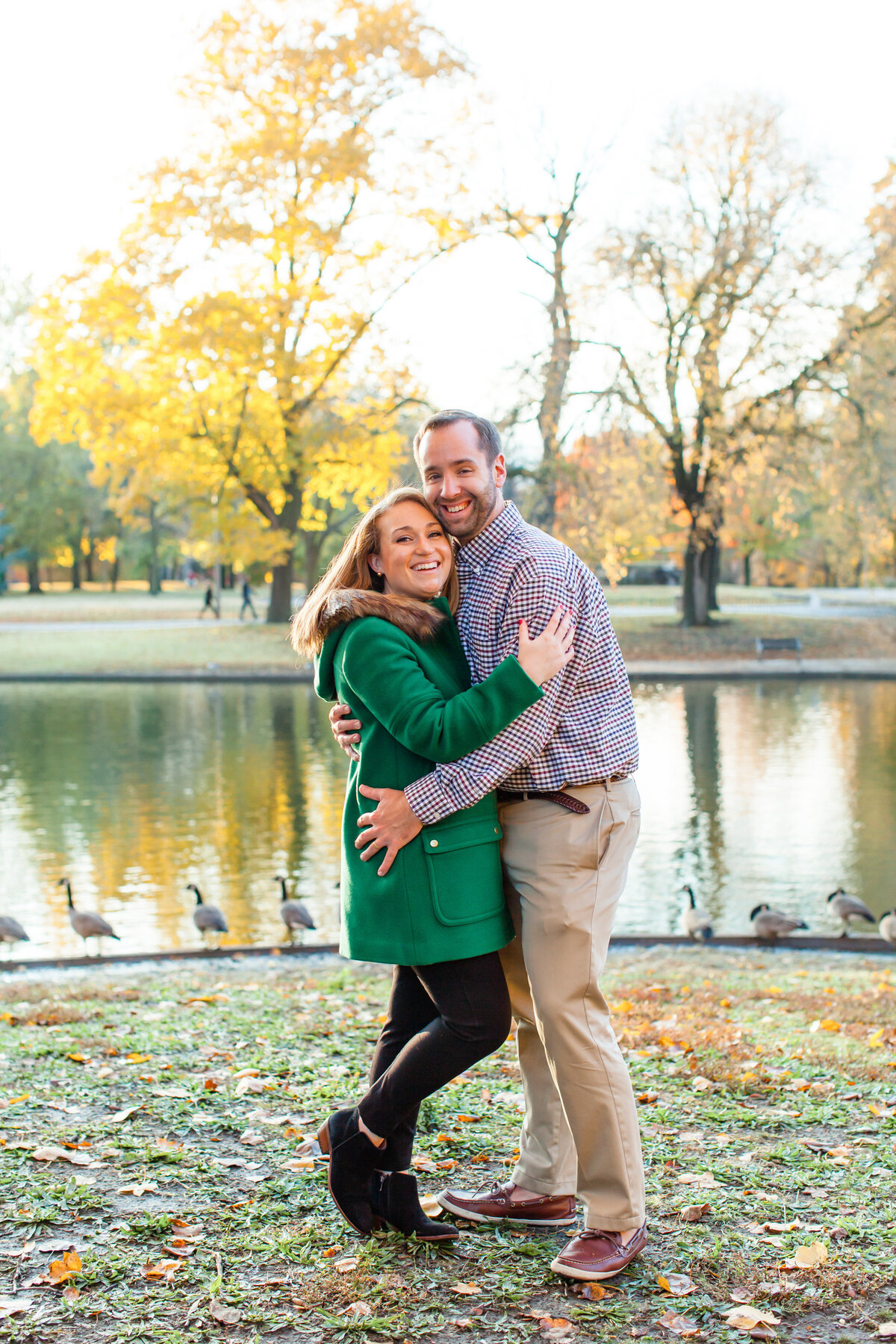 Winter Engagement  Session with green coat  couple laughing  at Lafayette Park in St. Louis by Amy Britton Photography Photographer in St. Louis