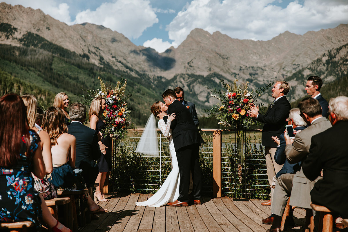 a first kiss in front of the Gore Range at Piney River Ranch