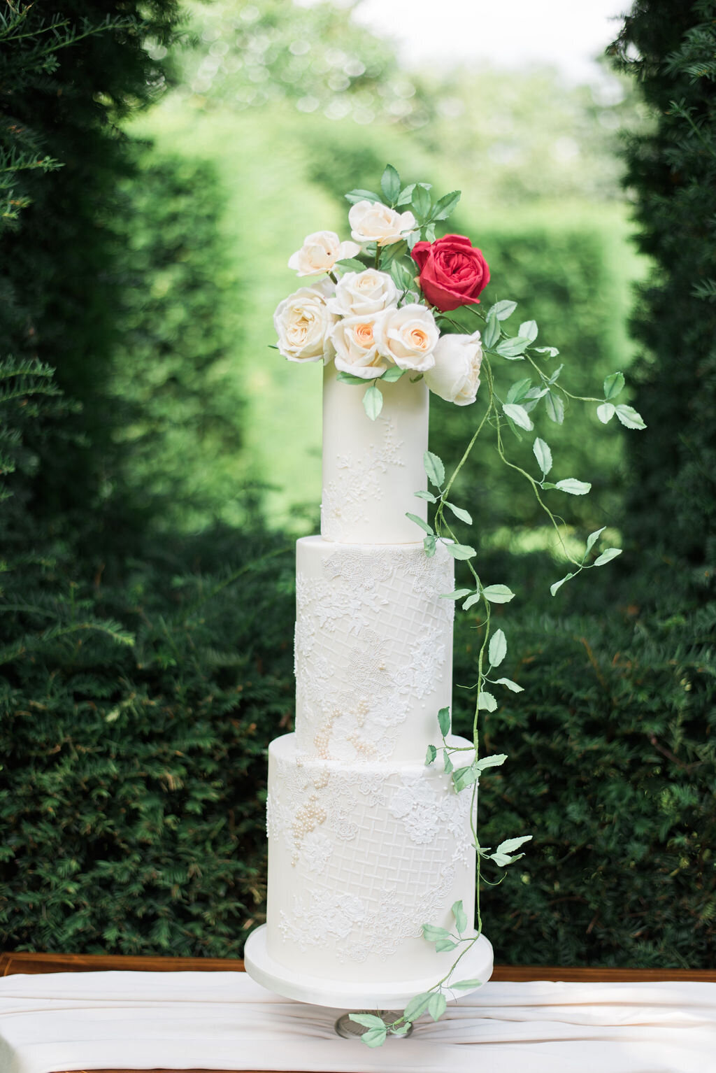 3 tier pearl white wedding cake with sugar flowers and foliage | MonAnnie