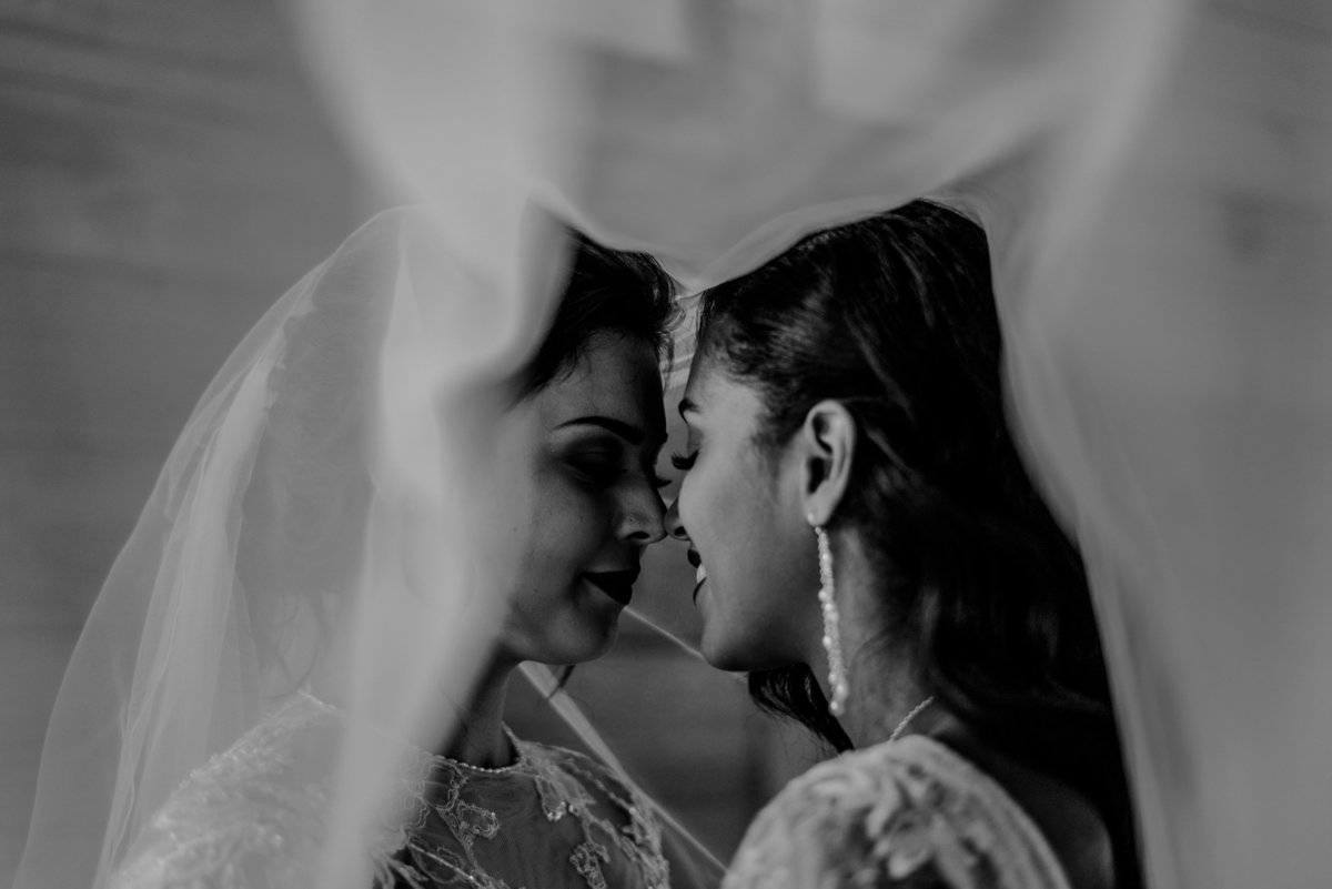 brides touching noses under veil