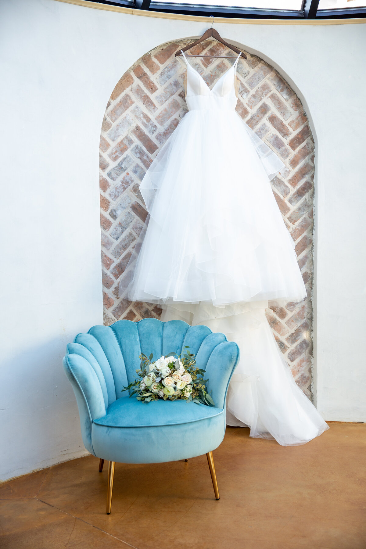 Brickhouse Bridal Gown Hung in the Observatory at Iron Manor