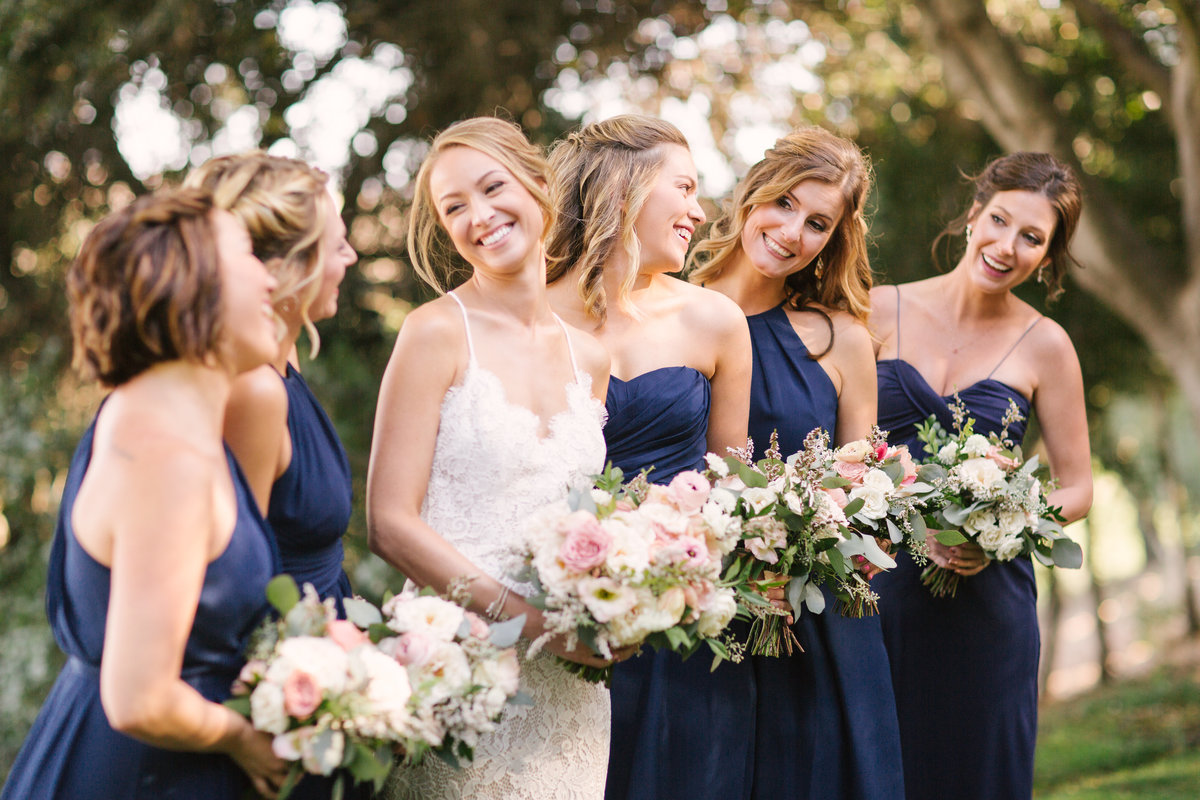 Bride looks at bridesmaids at Firestone Vineyard wedding