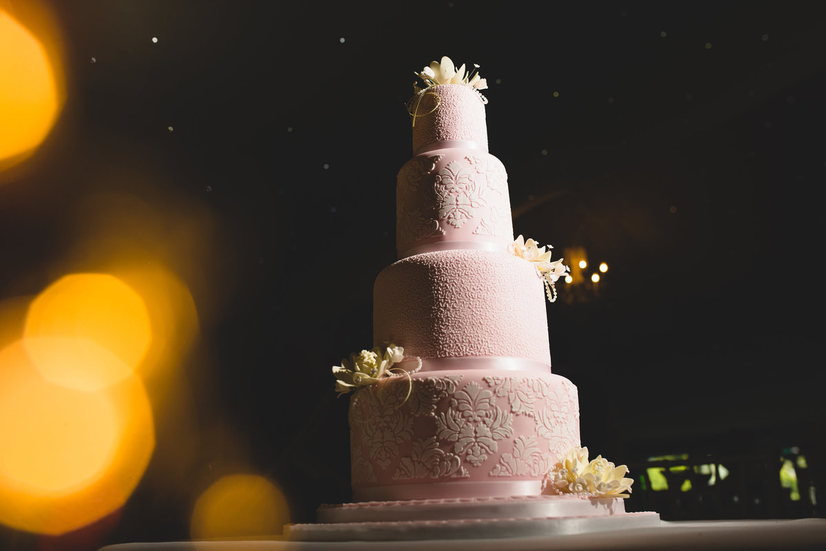 a pink 4 tier wedding cake