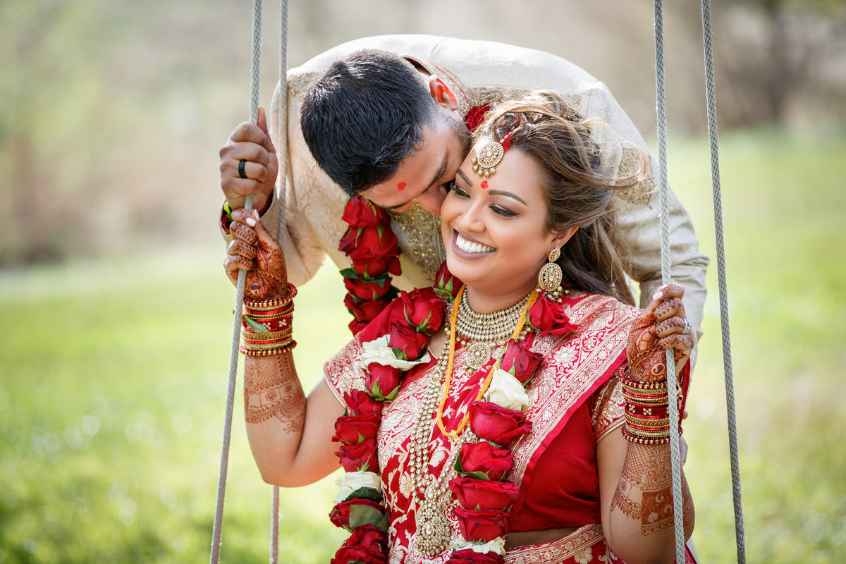 Indian wedding photographer pecan springs ranch bride groom swing natural light smiling happy colorful 10601 B Derecho Drive, Austin, TX 78737