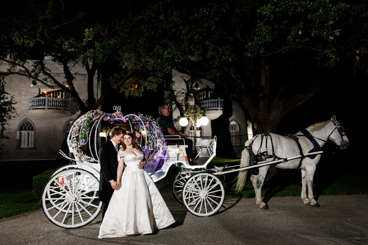 Austin wedding photographer castle avalon wedding photographer bride groom horse carriage