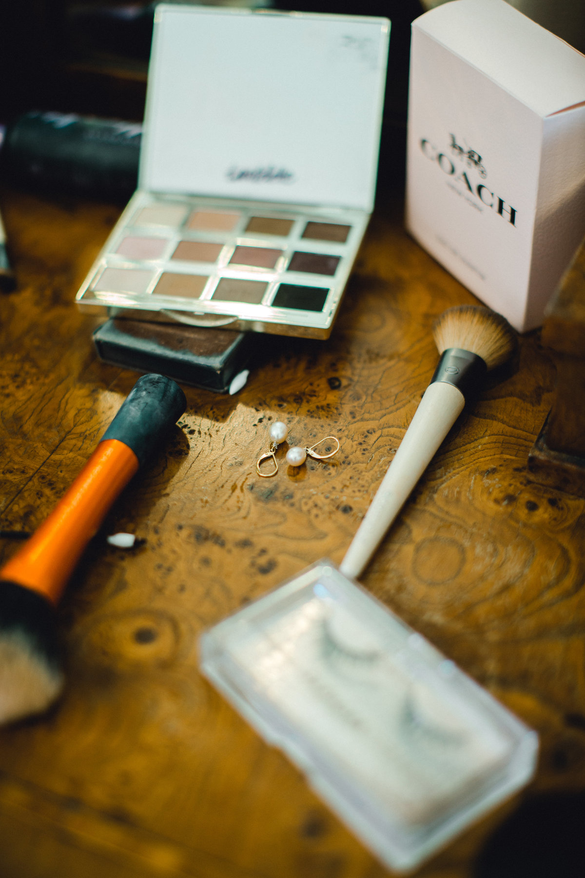 Makeup and jewelry details on vanity in bridal suite at Olympias Valley Estate in Petaluma California