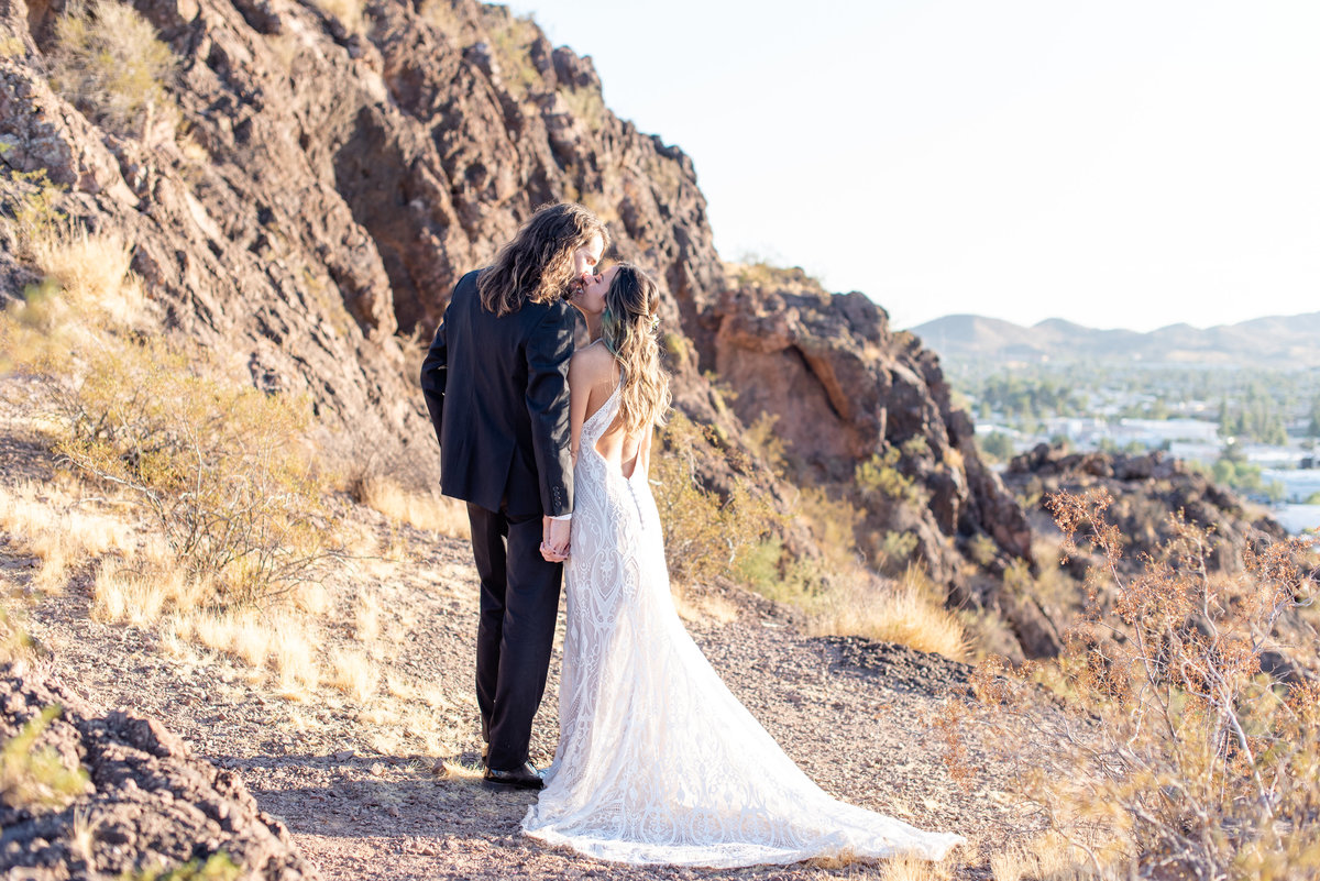 bride and groom hold hands facing away from camera in phoenix arizona