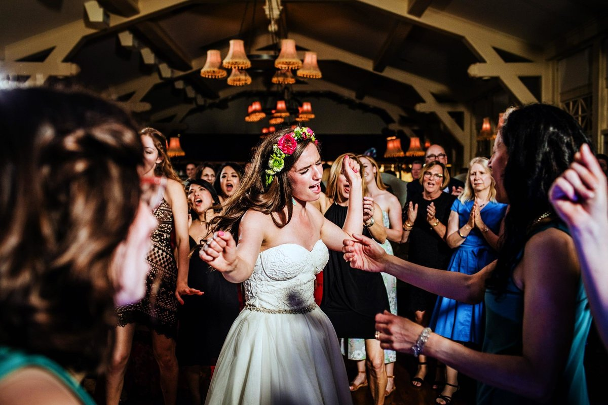The bride dances with guests at a Milwaukee wedding reception.