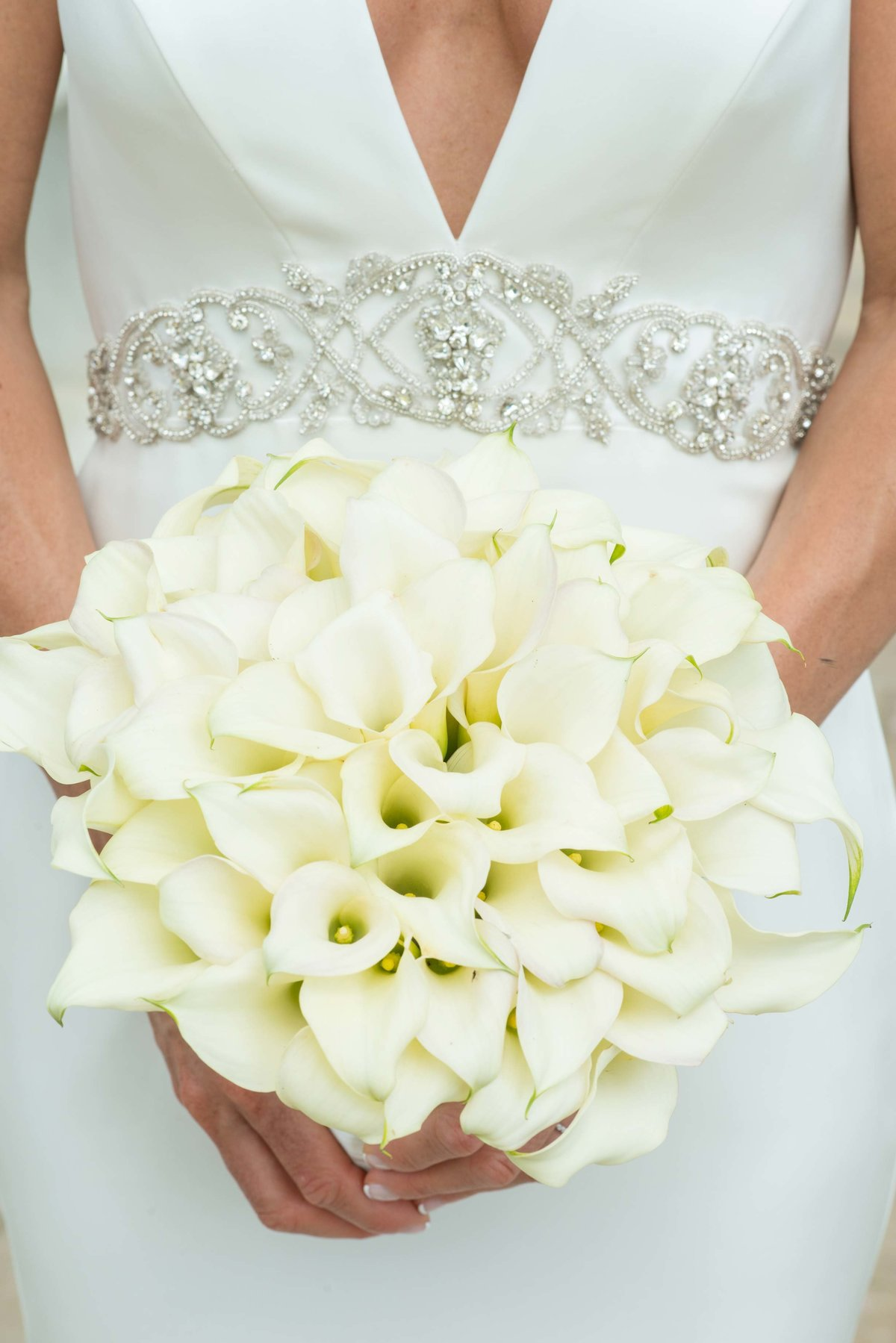 Bride with a white floral bouquet