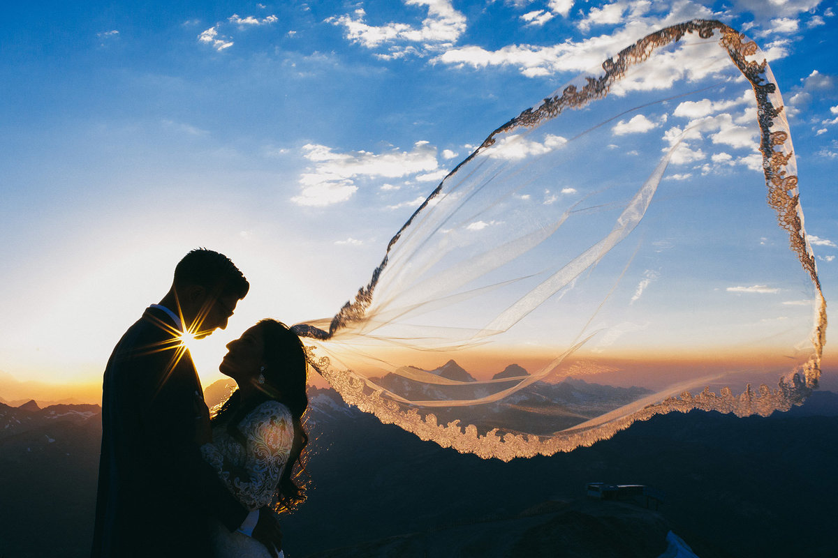 Bride & groom embrace during sunset after their Mammoth Mountain wedding at Mammoth Lakes, Ca.