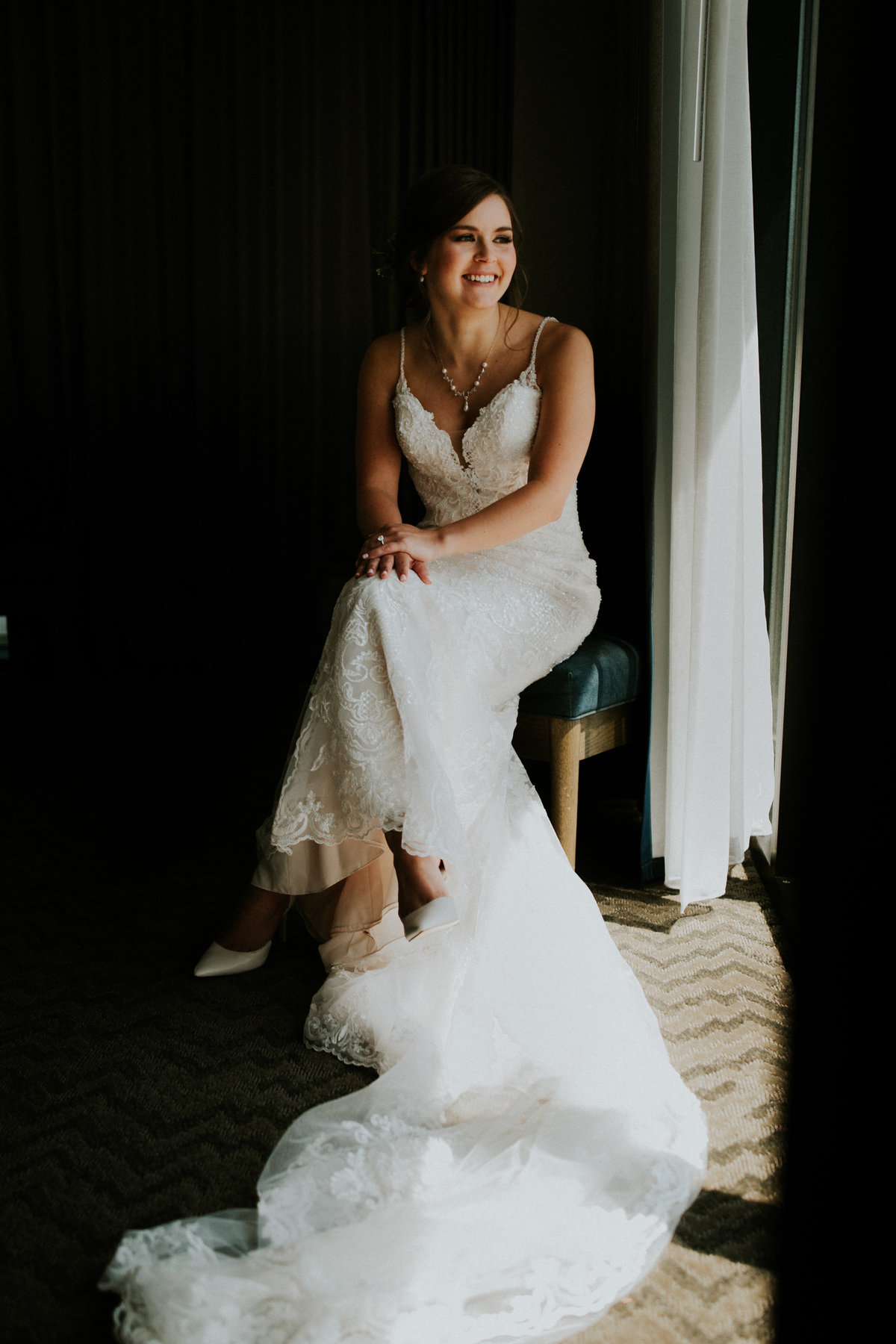 One of the top wedding photos of 2019. Taken by Adore Wedding Photography- Toledo Ohio Wedding Photographers. This photo is of a bride sitting with her gown spread out to show all the details. It was taken at the Renaissance Hotel in Toledo Ohio