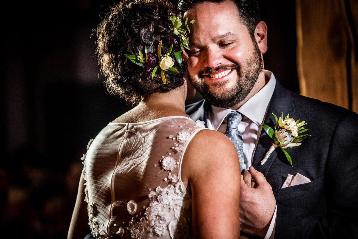 A couple shares a first dance together at a Lacuna Artist Lofts wedding reception in Chicago.