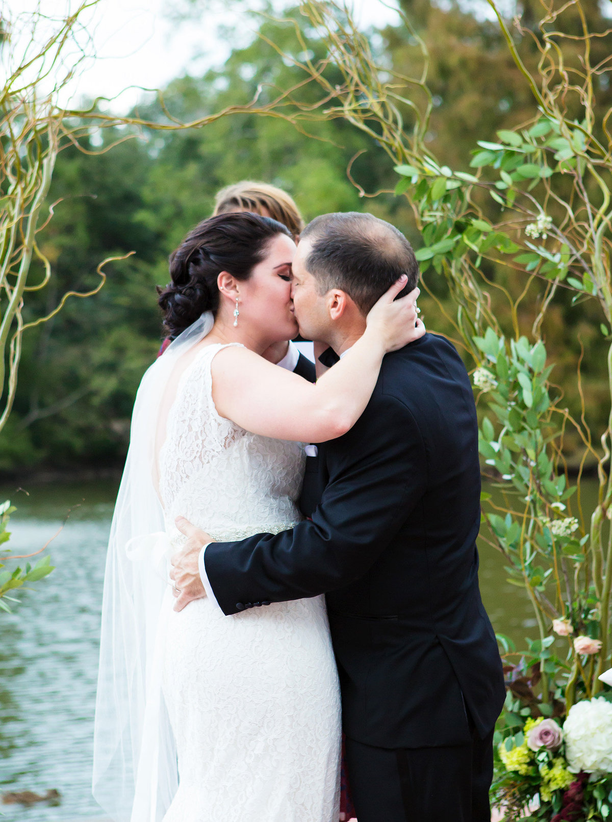NOLA wedding couple kisses after saying vows