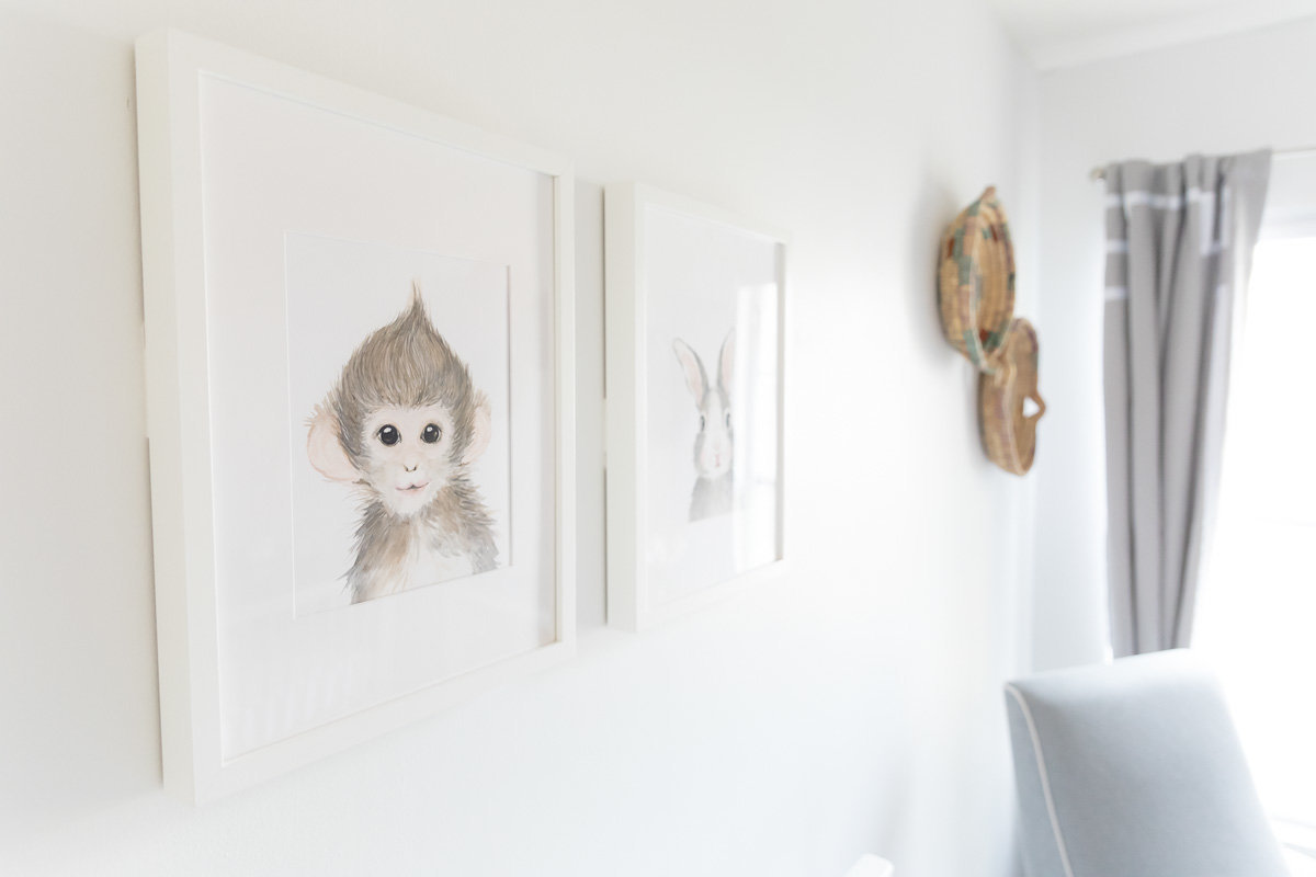 Animal watercolors adorn the newborn nursery