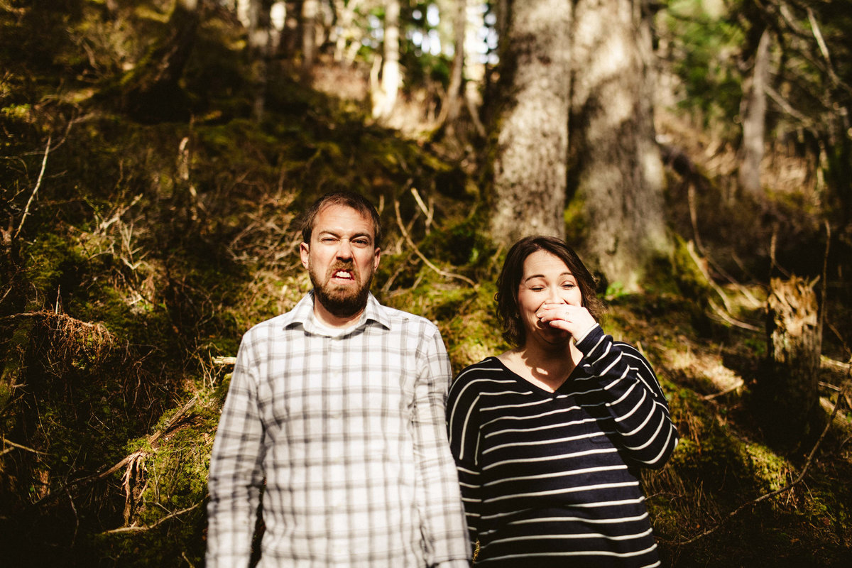 couple making funny faces in girdwood forest