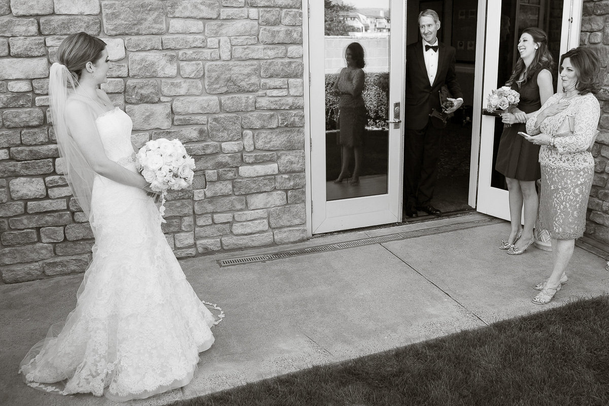 A dad sees his daughter for the first time on her wedding day at The Ritz-Carlton in Half Moon Bay.