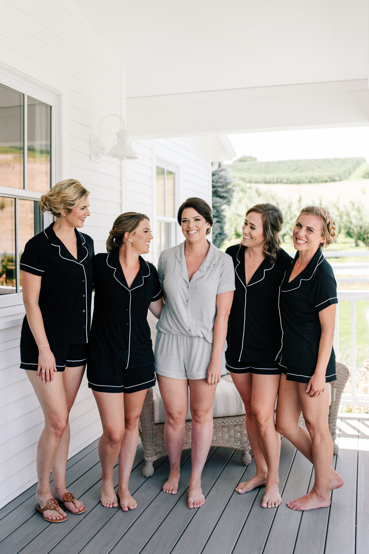 Bridal party in robes getting ready at the Harmony Meadows bridal suite