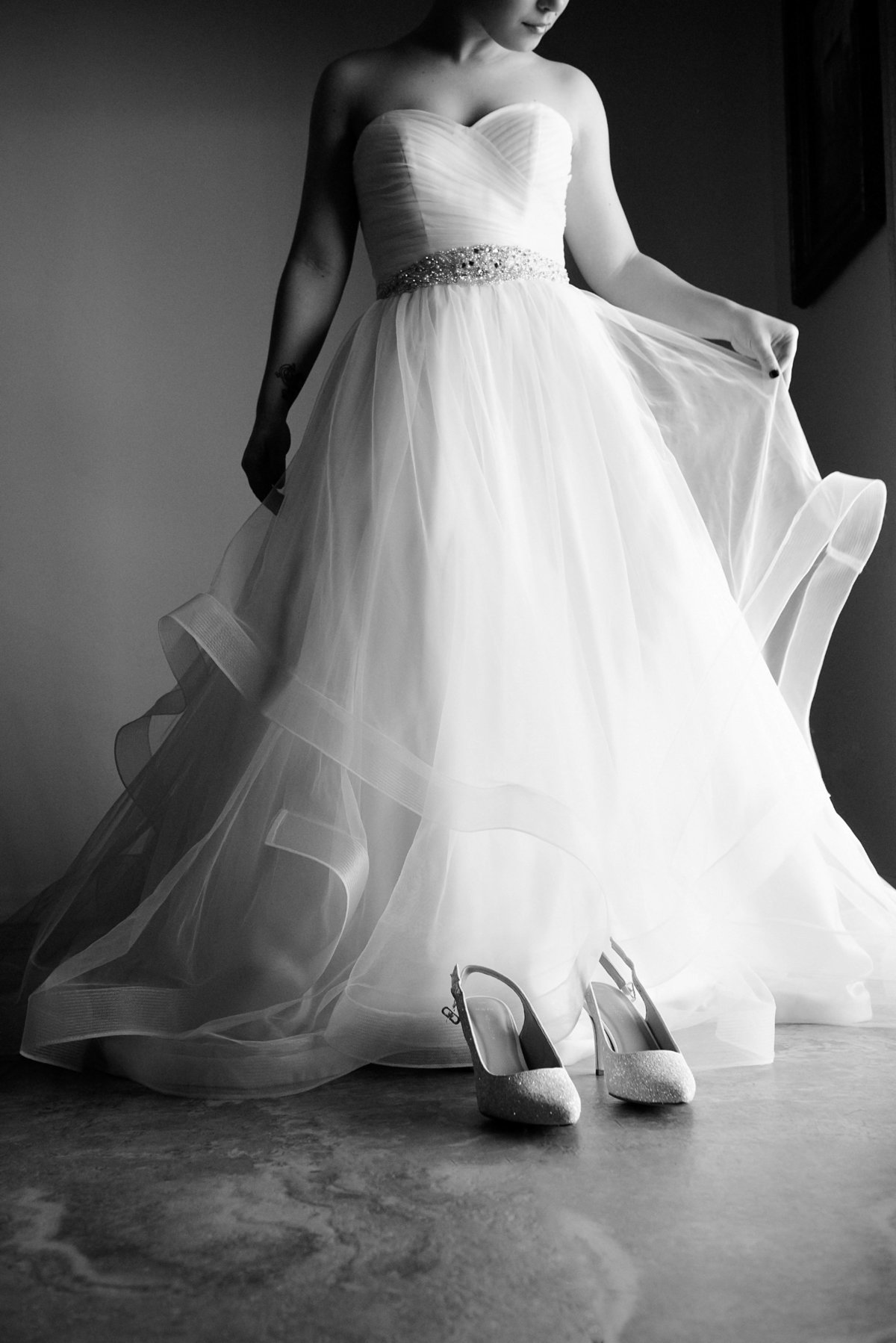 black and white of bride in dress