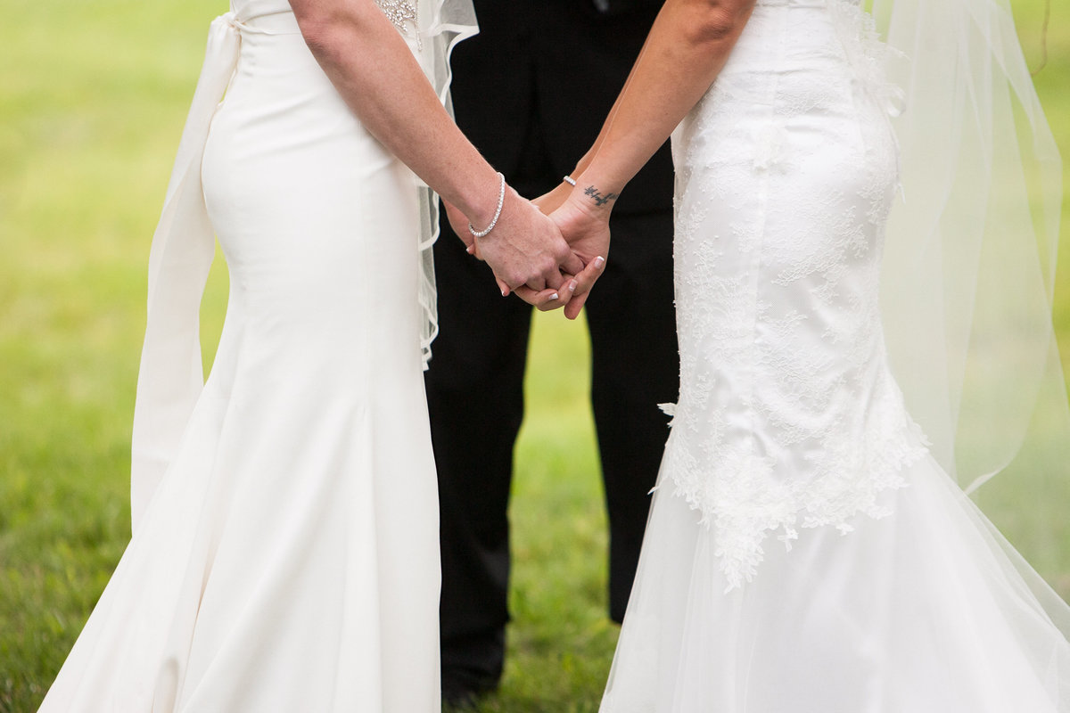 brides holding hands