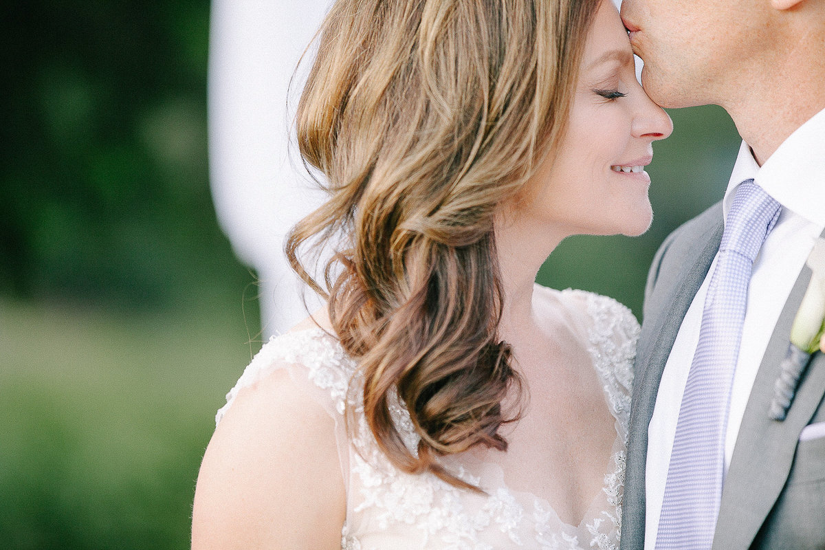 A sweet moment between a bride and groom on their wedding day at Calistoga Ranch.