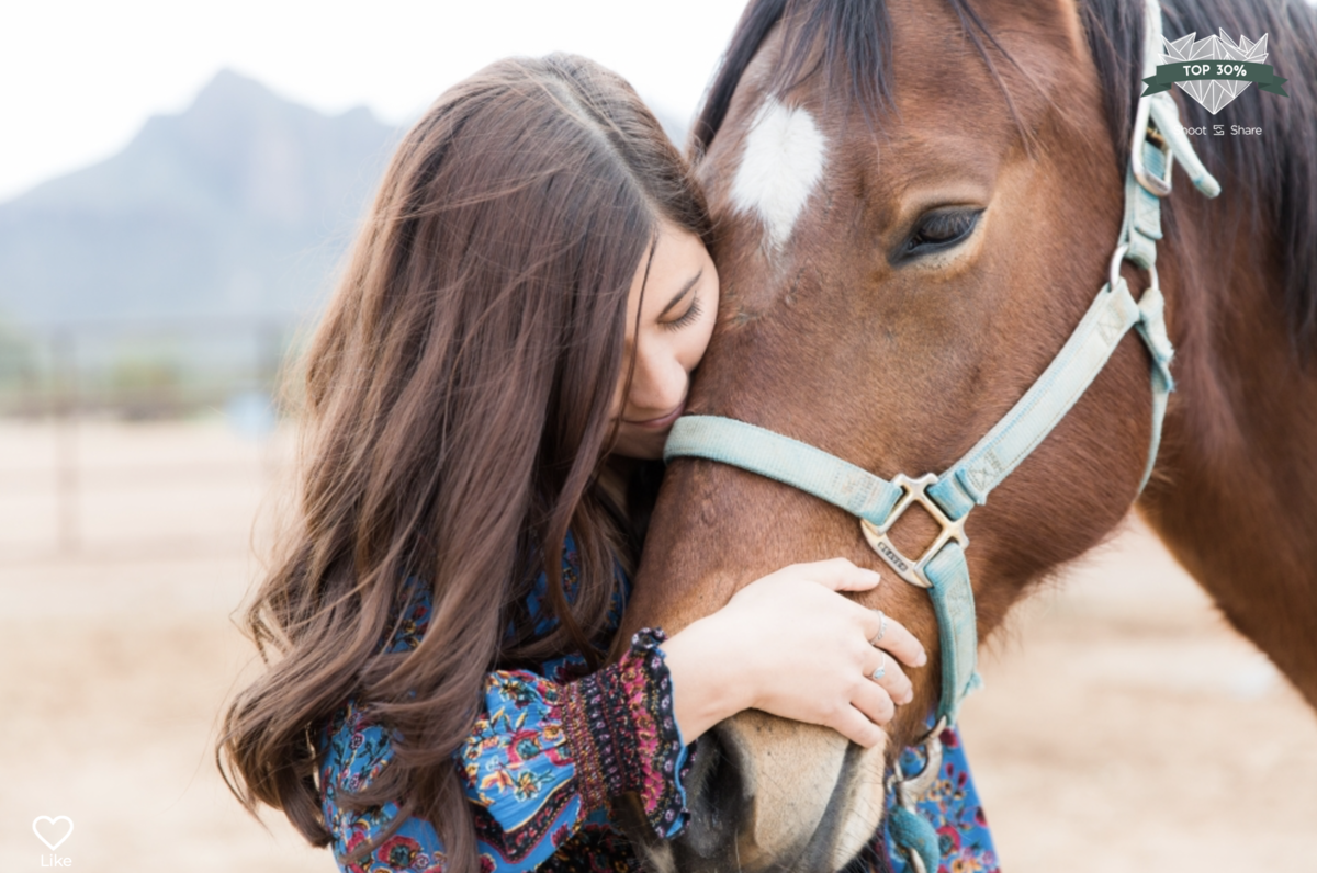 girl hugging her horse's face