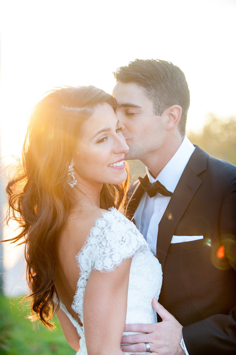 light bright wedding liberty house nj photography sunset golden hour kiss happy candid love